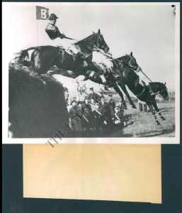 Battleship, in his menacing black hood, is in the lead and goes on to win the 1938 Grand National. An original photograph from my collection that inspired the article on Battleship published in September 2012 on THE VAULT.