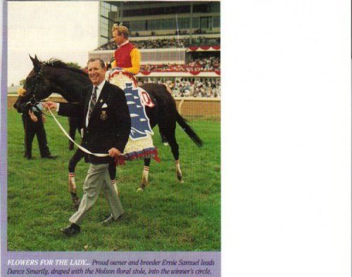 Wearing the Molson's Millions victory wreath, Dance Smartly and Pat Day are led into the winner's circle at Woodbine.
