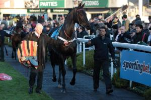 Sprinter Sacre shown here in the walking ring with his lad and best friend, Sarwah Mohammed.