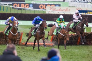 Nicky Henderson's Binocular (green) races with Hurricane Fly (royal blue).