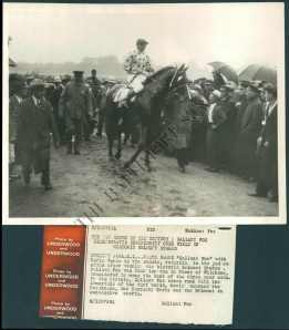 William Woodward leads in his Triple Crown winner. The Fox got a little fractious in the winner's circle even though his owner managed to hang onto him until Mr. Fitz arrived to take charge. Photo and copyright, The Baltimore Sun.