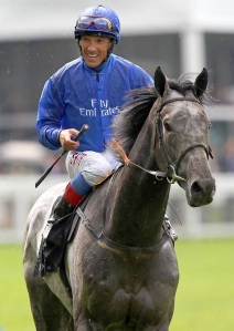 An elated Frankie Dettorri rides back to the winner's enclosure after COLOUR VISION'S win in the 2012 Gold Cup.