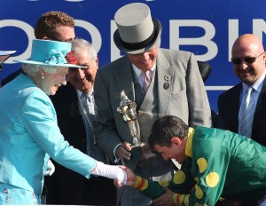 Queen Elizabeth II congratulates the winning jockey, Eurico Rosa Da Silva. (Photo & copyright, The Toronto Star)
