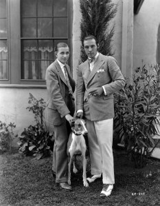 Rudolph Valentino in white flannels with a young Horace Wade in 1925. Wade was a child prodigy who went on to author some 800 articles and books on horse racing, He also served as the General Manager at River Downs.