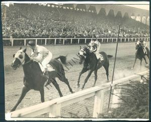 No matter how much weight they put on him, EQUIPOISE re-enacted this scene over and over again. Here he is, coming home under his regular rider, the great SONNY WORKMAN. Photo and copyright, The Baltimore Sun.