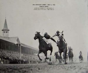 The famous photo of the 1933 Derby finish shows the jockeys fighting it out as BROKERS TIP (blinkers) and HEAD PLKAY come to the finish.