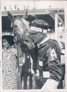 GREYHOUND gets a kiss from SEP PALIN following his victory in the 1935 Hambletonian.