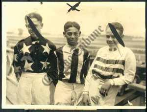 BOBBY JONES (centre) and two other unidentified jockeys at trackside in 1926.