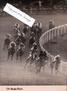 1950: A dramatic shot of fillies rounding Tottenham Corner in the Epsom Oaks that same year. ASMENA was the winner.