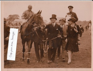 1927: Lord Durham leads in his Epsom Oaks winner, BEAM, who broke the existing track record.