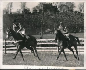 BLOCKADE and Colvill in the 1940 Maryland Hunt Cup, running behind the blinkered horse.