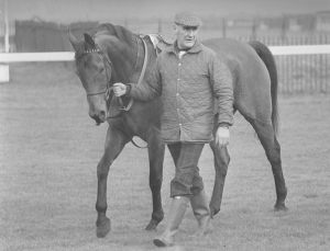 "Trainer GINGER McCAIN walking his champion, RED RUM. Ginger faithfully visited ""Rummy"" until the end of his days."