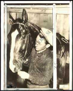 Another shot of Willie and the great OMAHA. The two understood each other well and Saunders was able to stop the big chestnut from savaging other horses during a race. However, following the Triple Crown, Saunders never rode Omaha again. Photo and copyright, The Baltimore Sun.