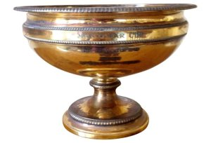 MAN O' WAR'S Gold Cup, aka the Travers Trophy.