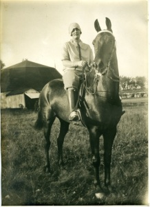 TOPSY NICO with Hilda Anderson. Photo taken by my grandfather, Carl L. B. Wheeler at Huntingdon Fair in Quebec in the 1920's/ early 1930's. Building in the background is a carousel where children took rides on wooden ponies.