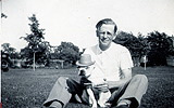 """My grandfather with the family's white Boston Bull Terrier, appropriately named """"White Teddy"""" (""""Teddy"""" after Teddy Roosevelt)"""