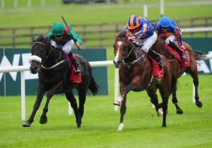 HARZAND digs deep to repel IDAHO (outside) in the Irish Derby.