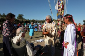 Chief Joe American Horse and Loretta Afraid of Bear honor ally Dayton Hyde with a naming ceremony. Wearing a blue dress in the background is Beatrice Long Visitor Afraid of Bear. Photo by Marisol Villanueva, courtesy of the Grandmothers Wisdom project.