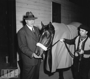 COUNT FLEET shown here with his trainer