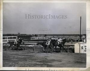 Edgemere Handicap, 1943: APACHE (blinkers) edges SHUT OUT to take the win, with MARKET WISE and Johnny Longden coming in third. Photo and copyright, THE BALTIMORE SUN.